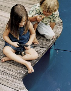Young Brother and Sister Fishing from Dock